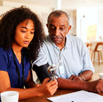 woman checking senior mans health